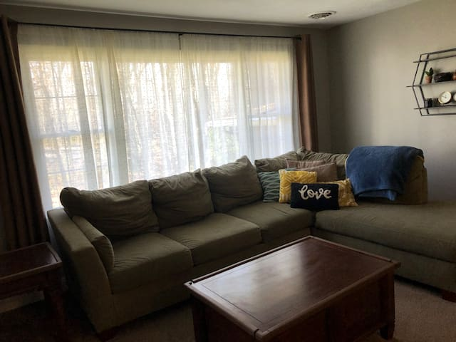 Plenty of seating in the living room to spend time relaxing before and after the game. Sofa can also easily sleep two adults.