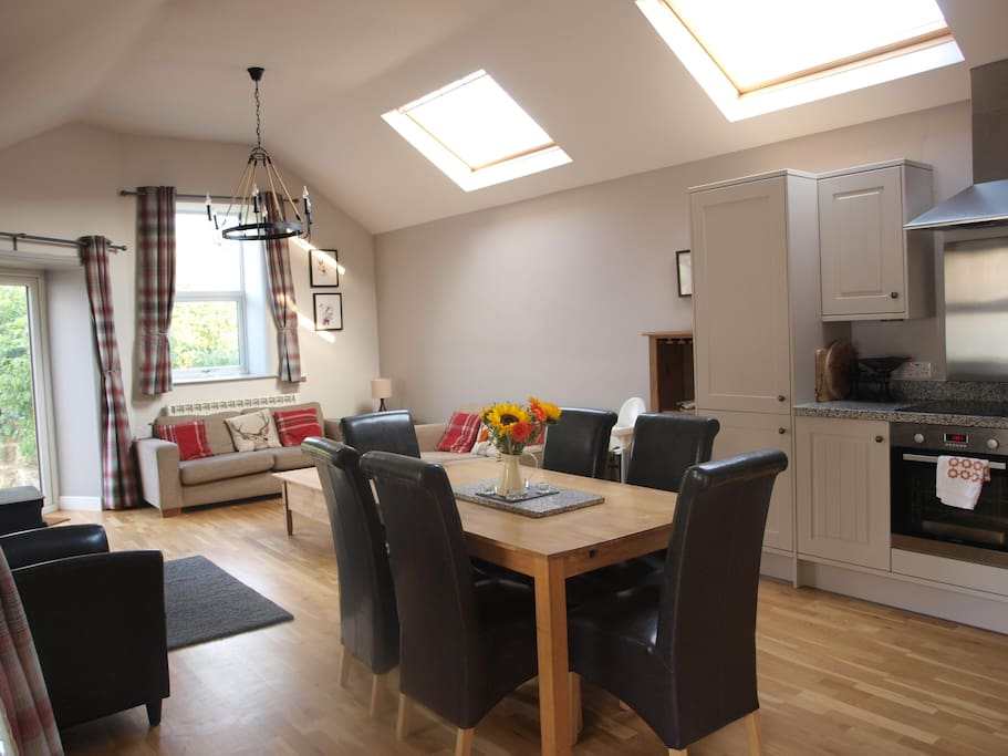 Velux windows and patio doors for lots of natural light.