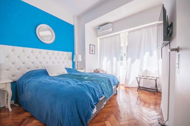 Room with Queen Size Bed with AC, Heat and Smart Tv windows with view to the front of the building