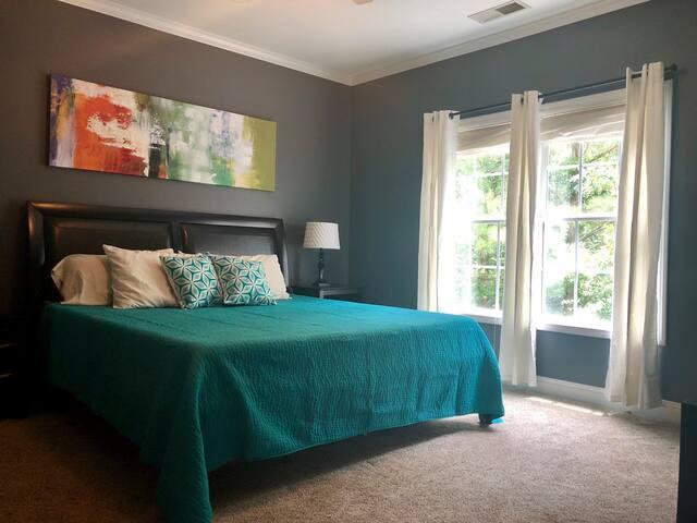 Master bedroom w/ king size bed and en-suite double vanity bathroom (located on 3rd floor)