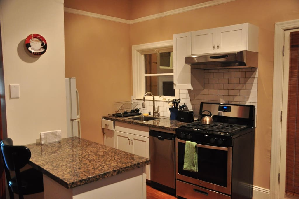 Complete kitchen with granite countertops, dishwasher, gas oven.