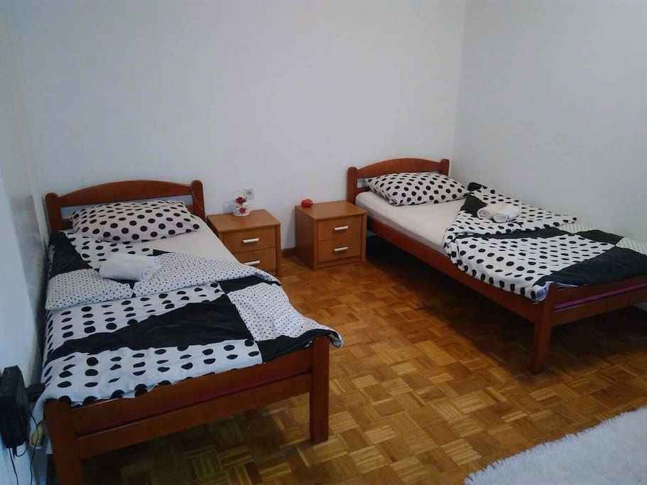 sleeping area with 2 single beds and one additional mattres