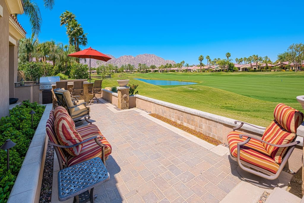 Back Patio and seating area overlooking Golf Course and Mountains