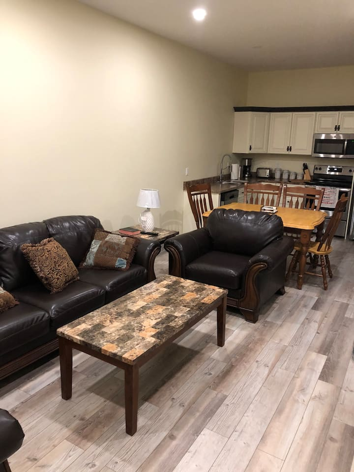 This unit is pet friendly, Each unit is about 900 sq.ft. Picture of Living room/ kitchen area