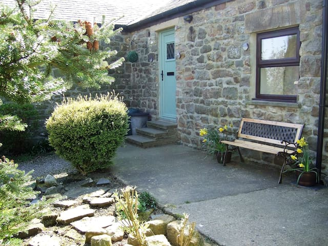 Enjoy a cuppa in the garden - this corner is a real sun trap all morning.