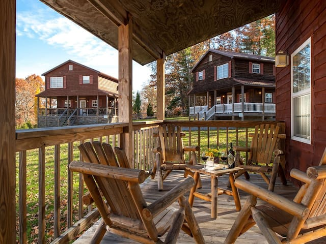 Rosewood Chalet front porch with laid back adirondack chairs.