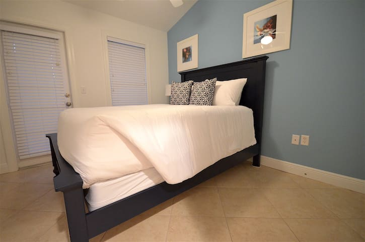 2nd upstairs bedroom with a queen size bed
