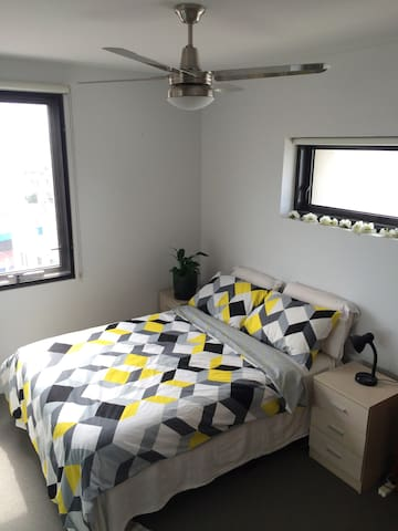 Ceiling fan over the bed is controllable from a remote and has several speeds.