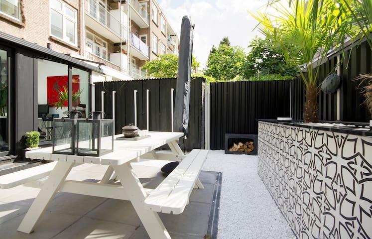 Design loft with sunroom and garden in trendy area