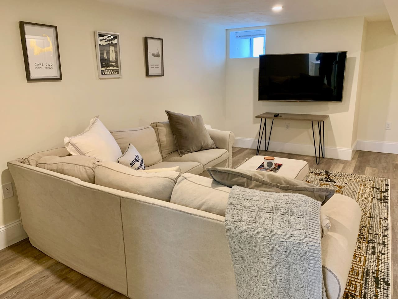 "Spacious living area with 55"" LED TV (Netflix, Hulu, AppleTV, Cable with 140+ channels) and a large comfortable sectional couch."