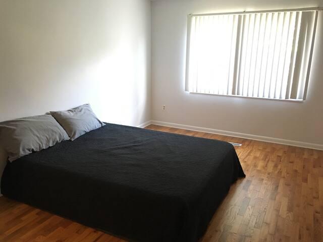 Minimalist bedroom with Casper mattress + box spring and  large walk-in closet