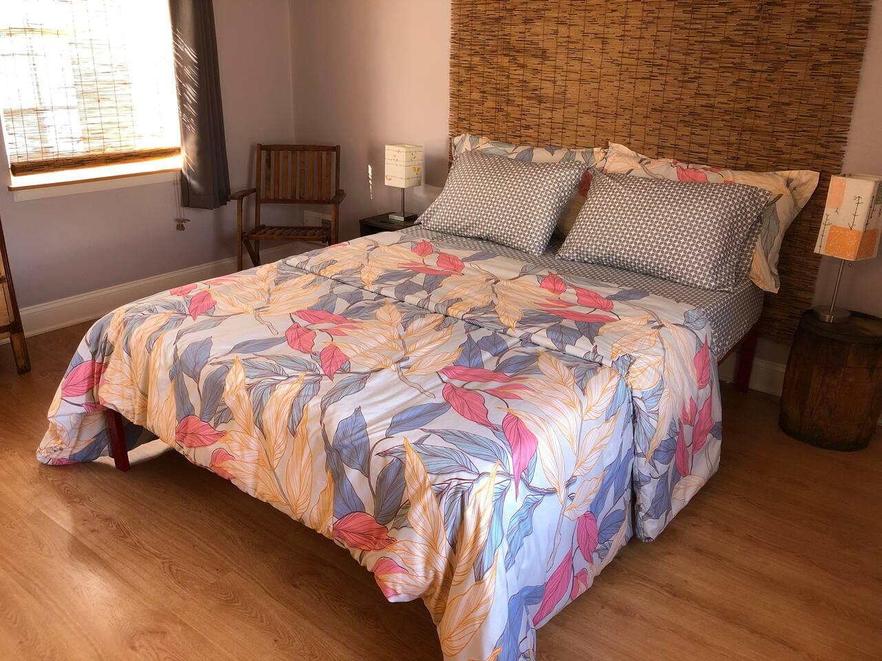 Third floor bedroom with queen bed