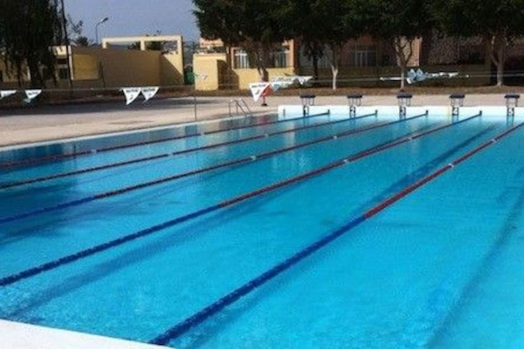 Piscina Municipal de Maspalomas. In less than two minutes walking distance. Cost two euros the whole day.