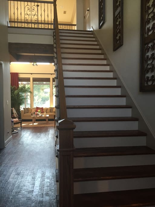 Stairs leading to the upstairs just inside the front door