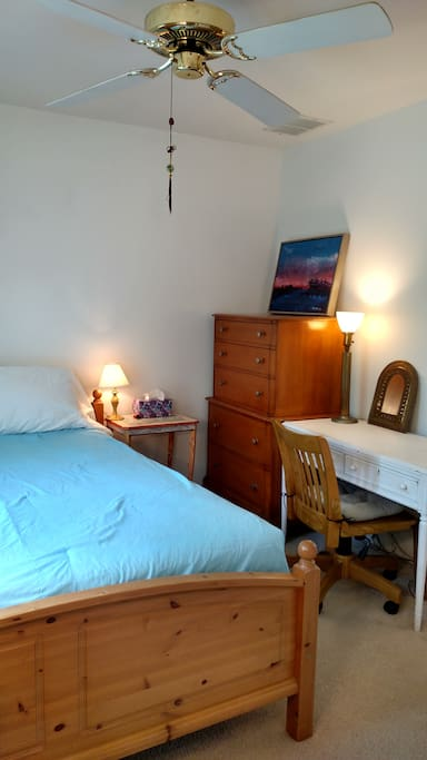 Overhead fan, bed, dresser, table, Chair, lamps (we also have air conditioning)