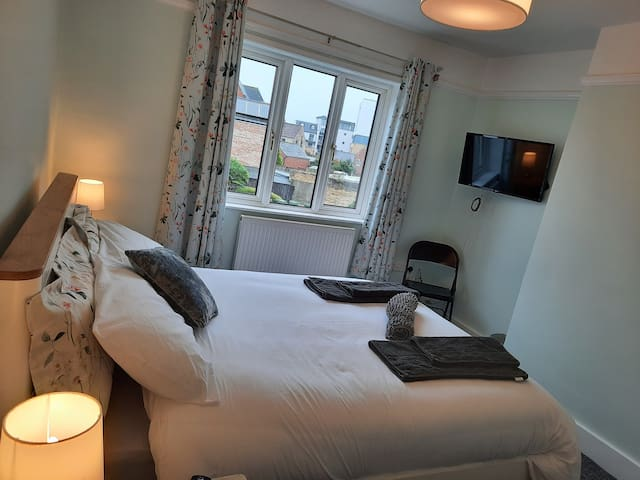 """Bedroom 1: By day...a view over the roof tops to Bicester Travelodge.  New 32"""" LED TV with remote, on a fully adjustable bracket."""