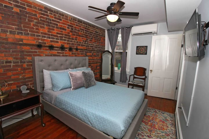 2nd floor full size bedroom with a smart TV with Hulu, Netflix, and Disney +