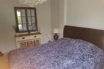 Main master bedroom containing double bed