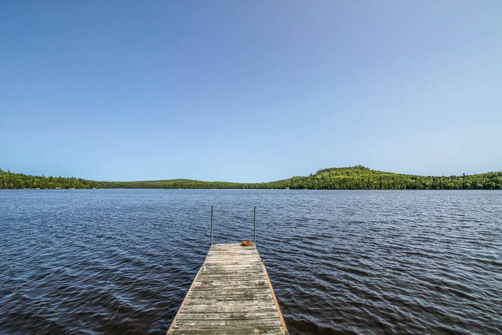 A gently sloping trail leads from the home to Caribou Lake and your private dock.