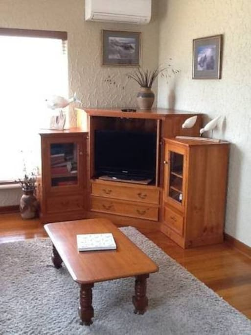 Flat screen TV, DVDs and phone dock.