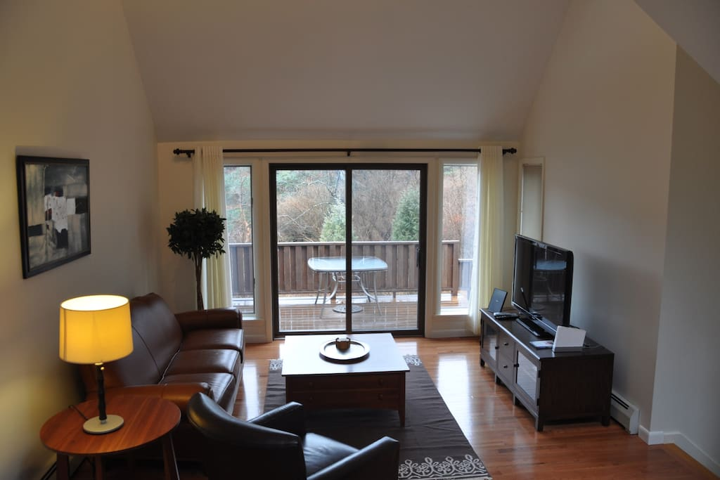 living room with sliding door to middle deck