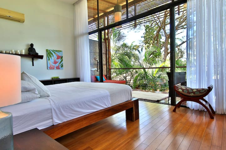 View from your master bedroom which opens to the lovely balcony overlooking the tropical gardens. Wake up in paradise.