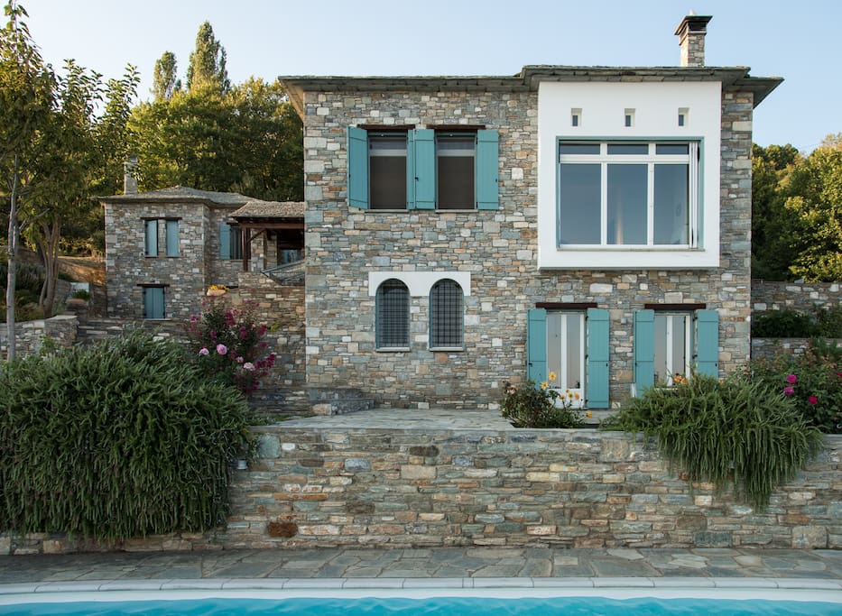 Stone built villa is a complex of two houses