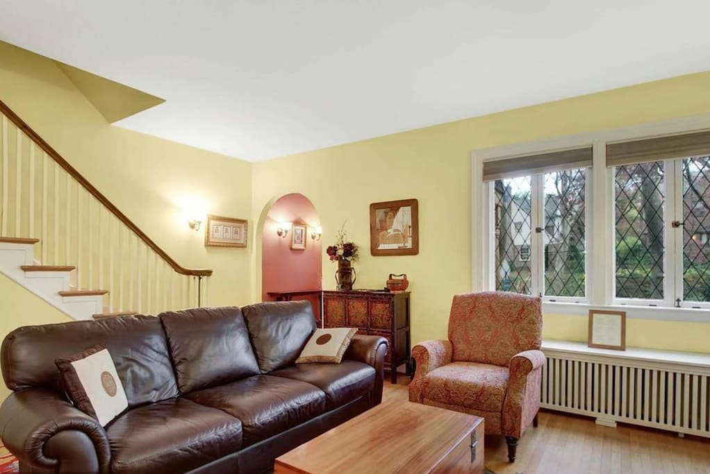 """Living room looking out onto tree-lined street voted """"prettiest in Baltimore."""""""