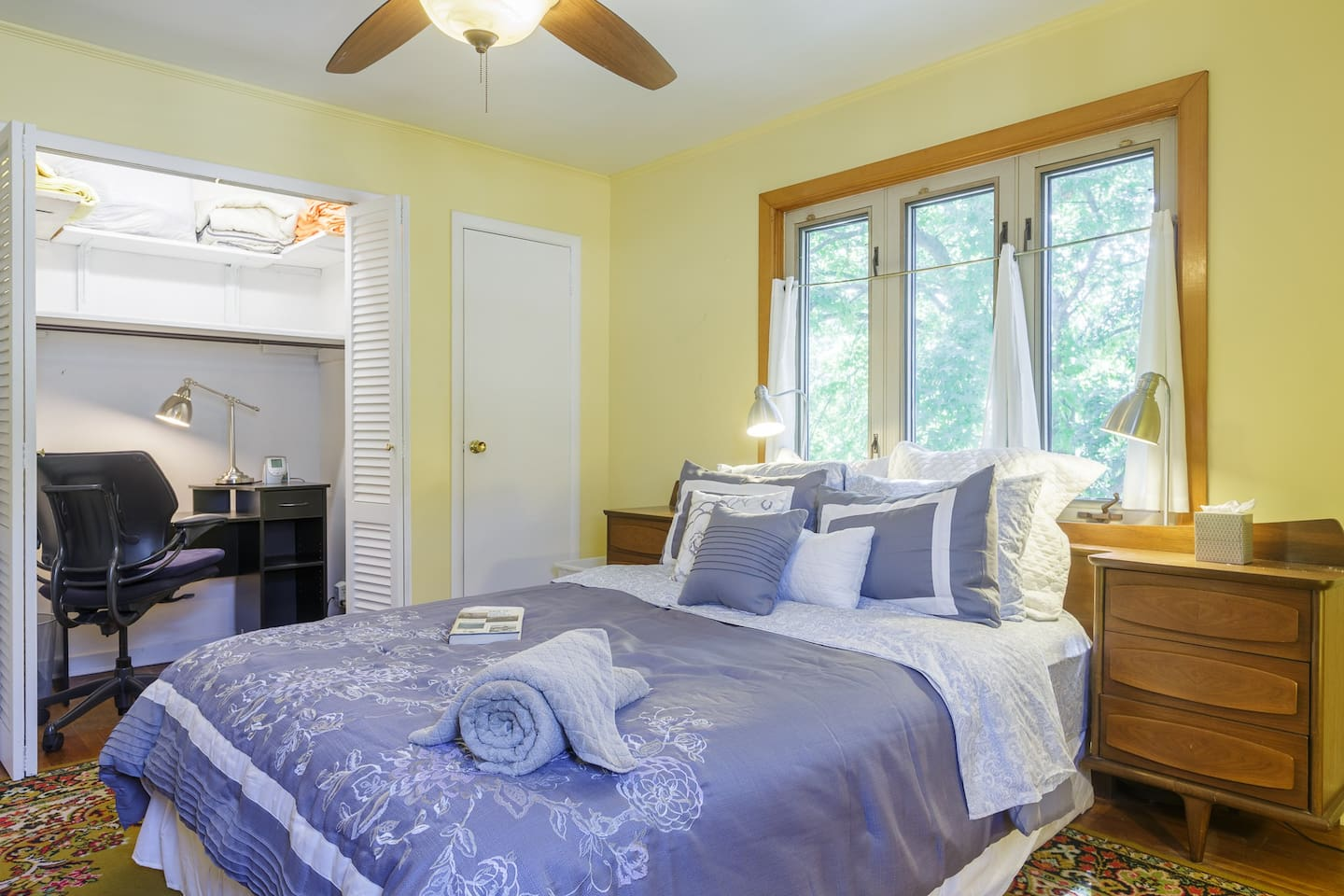 Large Bedroom includes closet, dressers, mirror, AC & home office