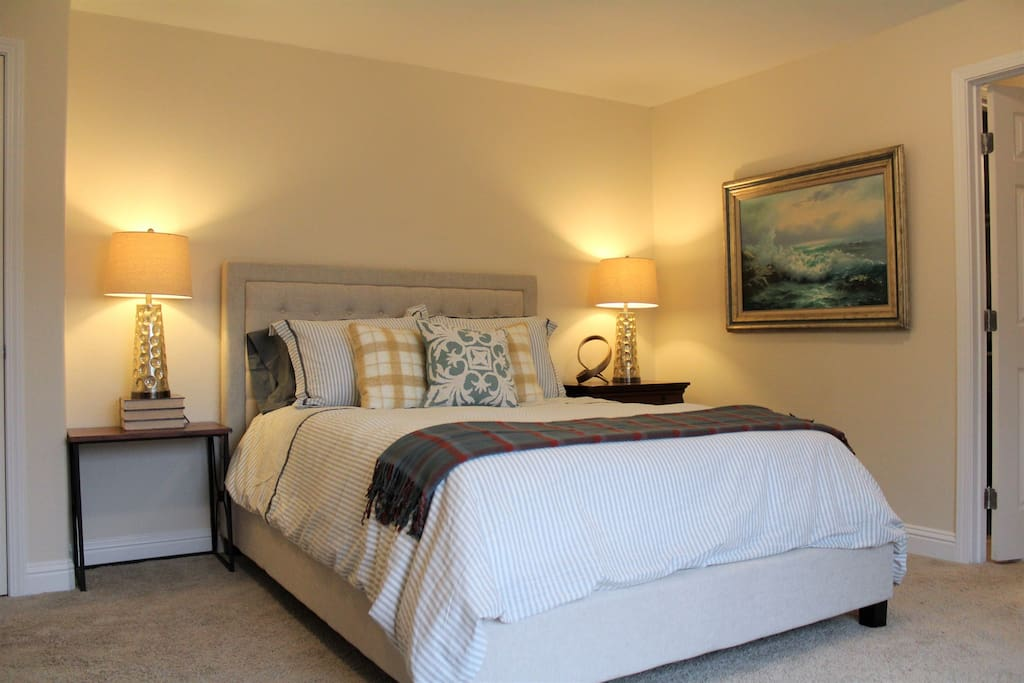 A bright and sunny retreat with an inviting comfortable bed.