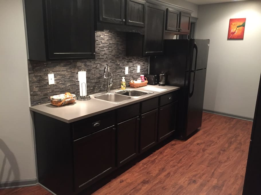 Kitchen with dishes and some basic necessities
