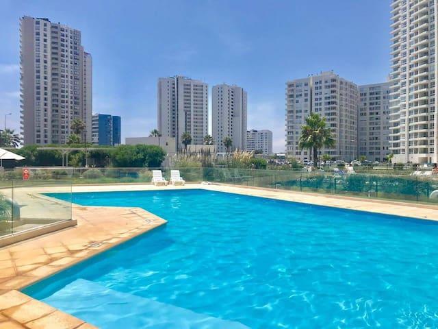 Departamento Serena vista al mar, jardín y piscina