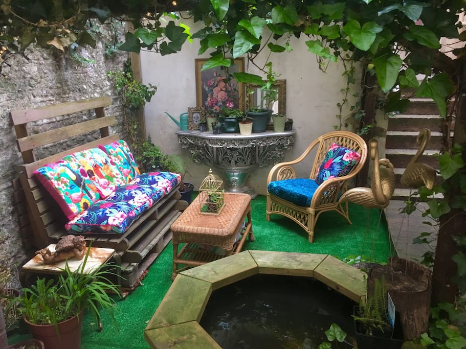 Your very own secret garden complete with goldfish and flamingos