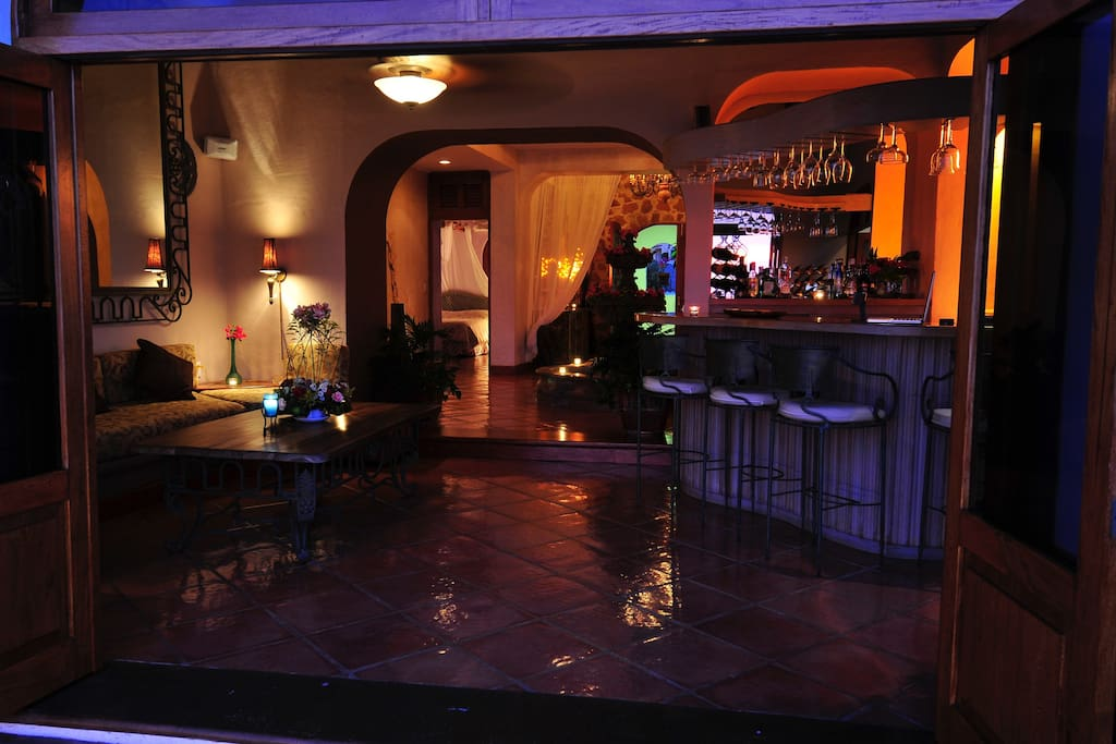 Bar and lounge area with access to the private pool.