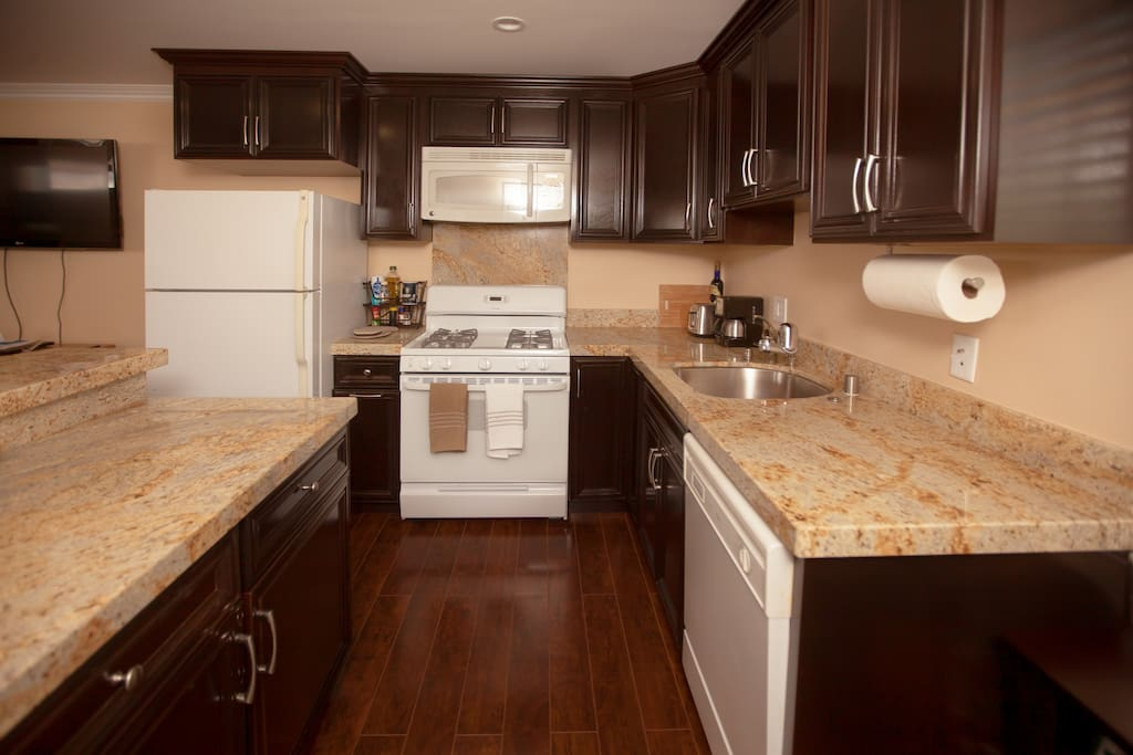 The kitchen is equipped with a full-size refrigerator, microwave, gas range and oven.  There is a generous and deep stainless steel sink with a garbage disposal and dishwasher.