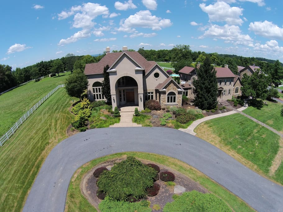 An aerial shot of the front of the house, in which your guest room is located!