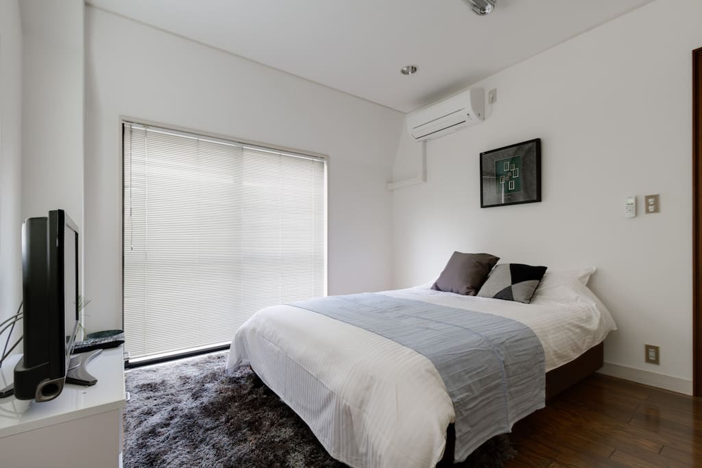 comfortable room with a tv and nice bed