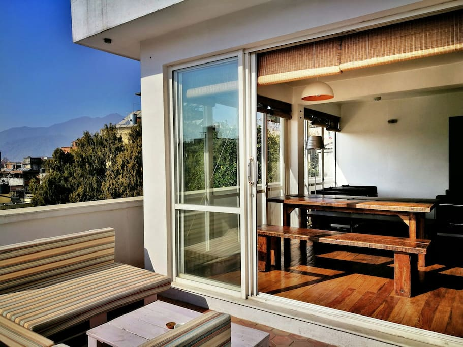 Sunny seating on the terrace with double sliding doors seamlessly connecting the indoors.