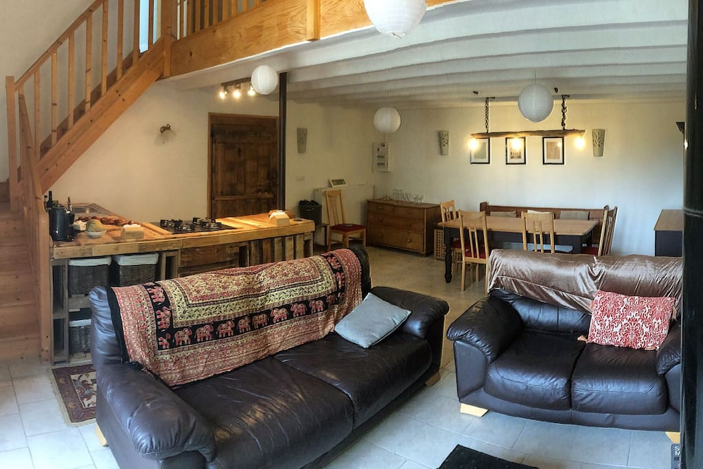 The downstairs area of La Vieille Grange, showing kitchen, dining and living areas.
