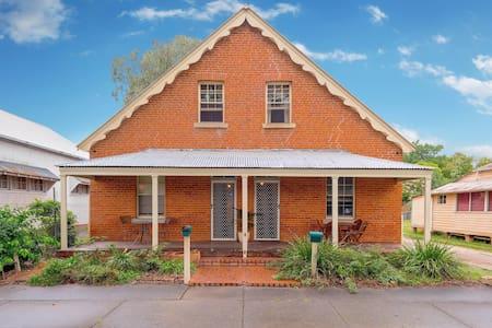 """Azile"" 1875 Victorian red brick Duplex"