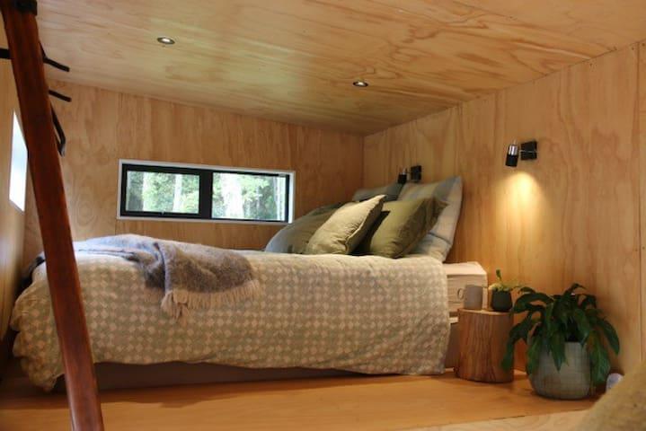 Comfortable queen bed in the relaxing loft space.