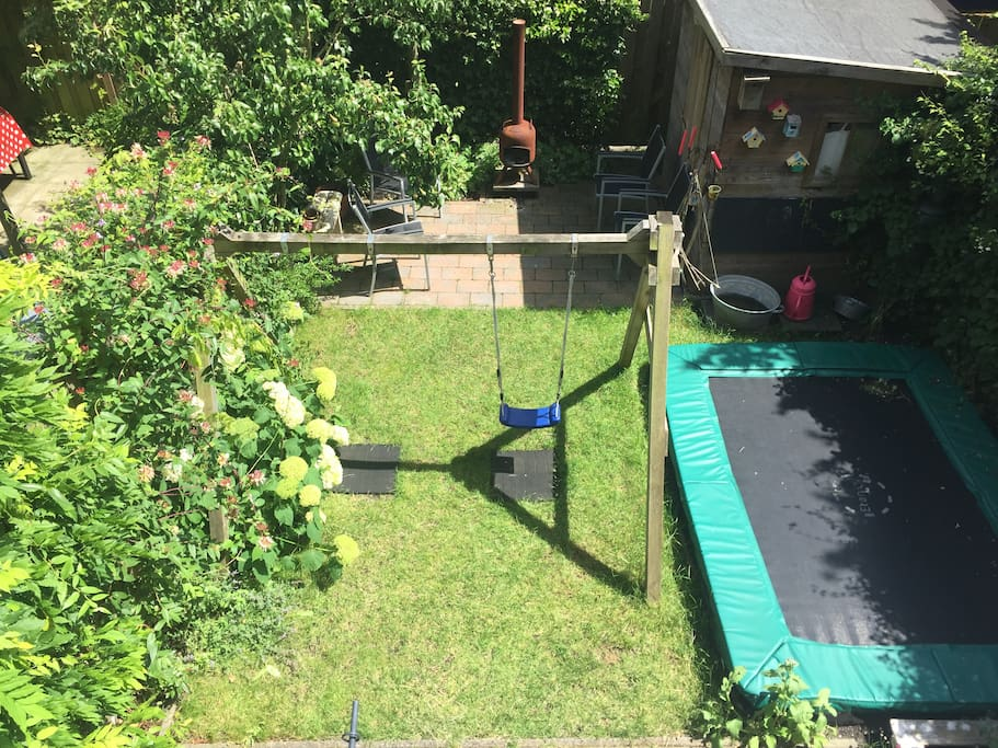Garden with swings and trampoline, little stove