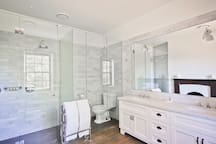 The Caroline Chisholm ensuite bathroom with twin showers and twin vanities.