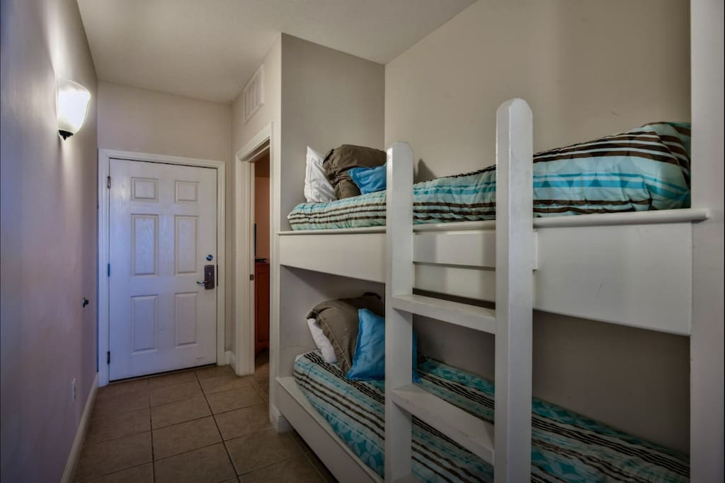 Bunk beds built into the wall in the hallway.