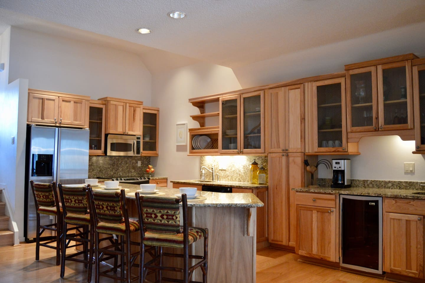 Large chefs kitchen with wine fridge and bar sink
