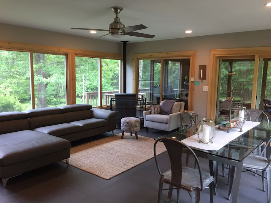 Family room connected to kitchen. Cozy pellet stove.