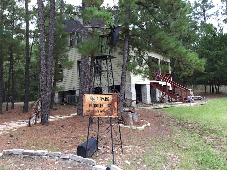 The rustic cabin in the middle of the 10 acres wood The welcoming front porch offers a wonderful opportunity to take in the unspoiled outdoors. This 10 +/- acre property provides a splendid surrounding to take in the walking trails, gorgeous pines, wildlife aplenty.