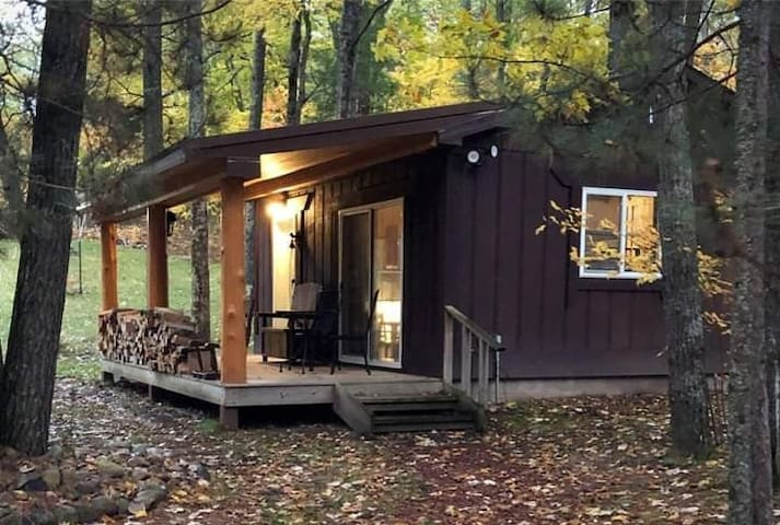 A cabin set on an outdoor oasis