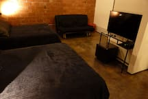 Room 2. (TV and sofa bed).