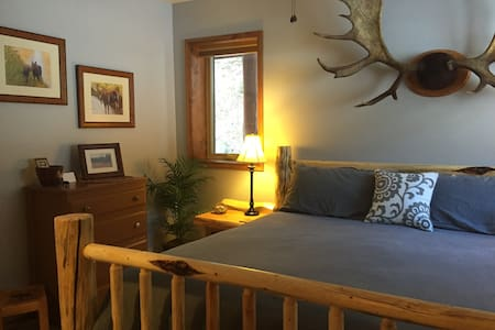 The Moose room with spacious king bed. Locally handcrafted log furnishings.